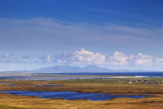 Hecla and Ben More, South Uist, from Clettraval, North Uist.