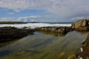 A calm rock pool in the foreground, while the great waves of Hosta close in!